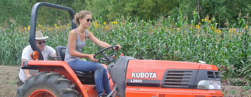 Ergon-Francesca-driving-a-tractor